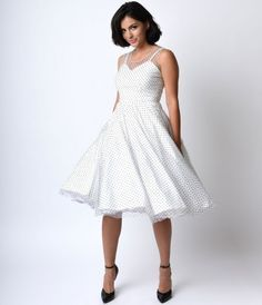 Divinity in dots, darlings! A gorgeous vintage inspired swing dress complete in a clean white and dainty black swiss dot...Price - $138.00-VqmhBmgD