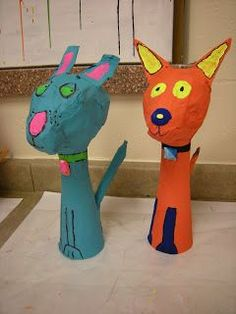 In Art class, fourth graders learned the difference between shape (2-D) and form (3-D) while creating these papier mache pets. Students could choose between a cat or a dog and they could decorate thei