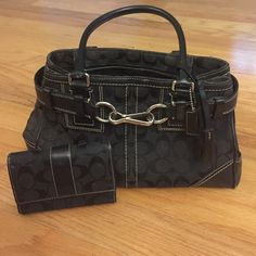 Authentic Black Coach Purse and Wallet Authentic Black Coach Purse (With tag) and matching wallet. Feel free to ask questions! Coach Bags