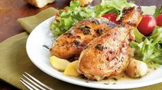 Gently simmered in a slow cooker with 40 cloves of garlic, this fall-apart chicken recipe serves as an easy dinner – special enough for Thanksgiving.