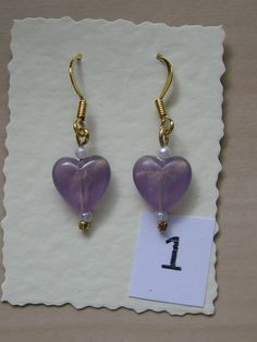 Gold Plated copper ear wires with glass mauve hearts and tiny pearls.