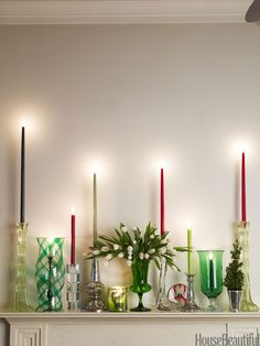 Instead of a garland, a great way to dress a mantel is to fill it with a mix of candlesticks — tall, small, mercury glass, crystal — and put a beautiful vase of flowers in their midst. Everything glitters. And instead of ivory candles, use red, cranberry, shades of green. That gives it another twist. Very festive!   - HouseBeautiful.com