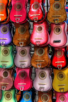 Colorful Music - A wall of colorful guitars.
