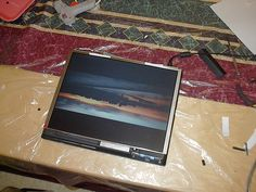 "A ""do it yourself"" digital pictureframe I made from an old IBM Thinkpad 600 laptop. The project was inspired by this guy's version I found online www.tacosntonic.com/pictures/Projects/Digital Picture Frame/    The frame/laptop is equipped with a USB wi Frames like this are superb. You can see some great frames here:"