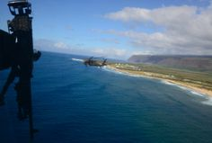 An Army Sikorsky UH-60 Black Hawk from the 25th Combat Aviation Brigade (25th CAB) operates off the coast of Hawaii during exercise Koa Kai 14-1 on Jan. 29, 2014. John M. Hageman/U.S. Navy