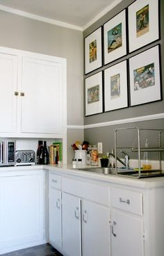 I like the light grey walls with the bright white trim and cabinets. I especially love the wall art with B-movie artwork.