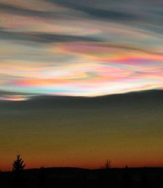 Polar stratospheric clouds, They are also called nacreous or mother of pearl clouds, and display a wonderful spread of shifting colours as the sunlight gets diffracted by the tiny ice crystals forming the nebulosity.