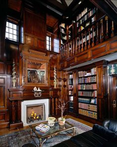 Traditional home library with dark-stained wooden furniture and ornate details