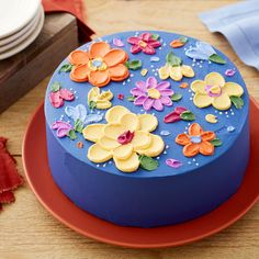 """You don't need a whole tip set to decorate this cake. Using an angled and tapered spatula, you can simply """"paint"""" flowers on your dessert! Great for birthdays, bridal showers and more, this Easy Painted Buttercream Flower Cake makes a great project for be Pretty Birthday Cakes, Pretty Cakes, Cute Cakes, Cake Birthday, Birthday Cake Designs, Gateau Aux Oreos, Mini Cakes, Cupcake Cakes, Frog Cakes"""