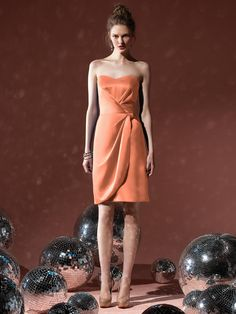 Orange Bridesmaid. View more tips & ideas on our Facebook Page : https://www.facebook.com/BoutiqueBridalParty
