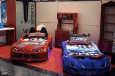 Race car kids beds in red and blue with matching decor 55 Gorgeous Kids' Bedroom Finds That Amaze and Delight. Cool Bunk Beds, Kid Beds, Teenage Girl Bedrooms, Girls Bedroom, Race Car Bedroom, Kids Car Bed, Kids Bedroom Designs, Bedroom Ideas, Bedroom Decor