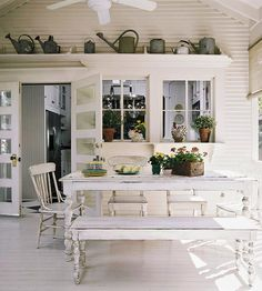 Decorating Inspiration: Displaying Collections in Your Home : A collection of vintage watering cans displayed along a tall shelf in this shabby chic porch adds the perfect decorative touch : drivenbydecor #sunroom