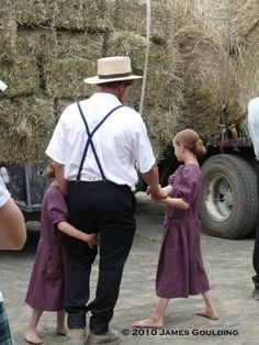 'Amish father with daughters