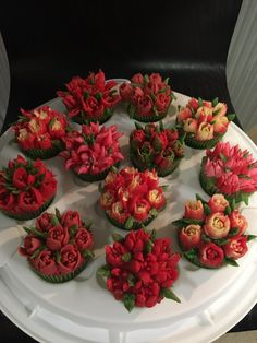Flower cupcakes for my sister's birthday. Marbled cupcakes with strawberry and vanilla buttercream frostings. Flowers achieved using Russian piping tips.