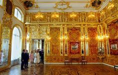 """""""the amber room"""" russia  tons of real amber were used to decorate everything in this room for Peter the great. every piece was stolen by the nazi's at the end of wwII -never found this is a replica built in 2003"""