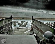 Into the Jaws of Death. June 6, 1944. colorized by Avi A. Katz. A LCVP (Landing Craft, Vehicle, Personnel) from the U.S. Coast Guard-manned  USS Samuel Chase disembarks troops of Company E, 16th Infantry, 1st Infantry Division (the Big Red One) wading onto the Fox Green section of Omaha Beach (Calvados, Basse-Normandie, France) The original photo was taken by Chief Photographer's Mate (CPHoM) Robert F. Sargent.