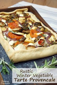 This rustic, free-form Tarte Provencale is filled with flavorful roasted winter vegetables and creamy goat cheese. It is the perfect recipe for a comforting winter appetizer. #FreshTastyValentines   www.CuriousCuisiniere.com