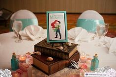 Tables themed as different Disney movies    So, basically my wedding idea! Nice to see that it will turn out awesome!