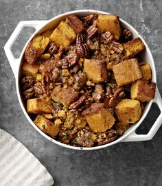 This recipe by the Beekman Boys calls for Supermoist Cornbread. If using cornbread for stuffing, make it two days prior: Cut cornbread into 1-inch chunks, place on a large baking sheet in a single layer, and let dry out at room temperature for two days. Recipe: Cornbread Stuffing with Pecans and Sweet Sausage     - CountryLiving.com