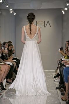 """Nava  Ivory satin faced silk georgette gown with hand embroidered sequin and pearl """"V"""" neck bodice.  www.theiacouture.com"""