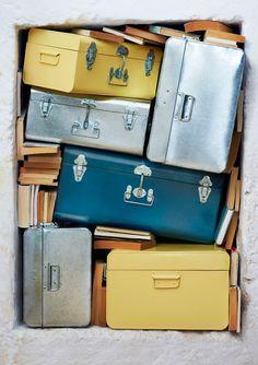 Teal, silver and bright yellow storage trunks from Toast. These fellas make clutter look fiiiiiiiine
