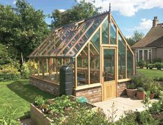 Beautiful cedar greenhouse, nice ground wall too. http://garden-greenhouse.se/
