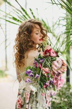 Oversized king protea wedding bouquet.  From 'Red hair and red lipstick, from 'Claire Pettibone's 'Still Life' Collection ~ Ethereal and Whimsical Wedding Dresses'    Photography - http://jesspetrie.com/  Styling - http://www.whiteroombridal.co.uk/  Gowns - http://www.clairepettibone.com/  Florals - http://www.campbellsflowers.co.uk/Page/Show/2/Home