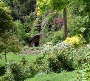 Belvoir Castle woodland garden, England.  A much-rebuilt Norman castle with a mid-nineteenth century garden. Terraces step down the hill. There is a rose garden made by the head gardener (William Ingram) in the 1860s and woodland gardens made by the present Duchess.