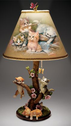 Features Jürgen Scholz kitten art on shade, hand-sculpted kittens on tree-shaped base. Butterfly finial, mahogany-finished base.