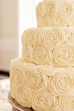 Bedecked with swirls of roses, this confection is a dreamy knockout. And how cute would it be with a burlap rosette topper??