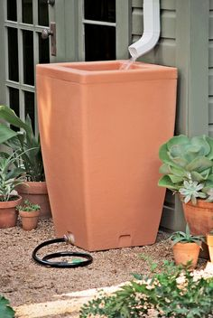 Santa Fe, 47 Gallon Rain Barrel - an attractive option for collecting rain water!