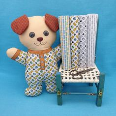 """""""Dog in Pajamas"""" is  a Cut and Sew Softie fabric panel. This is a do it yourself project with the instructions on the fabric panel. The fabrics on the chair are also available in my Spoonflower shop. Link in Profile."""