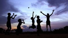 Children play after the sun goes down in Bhubaneswar, India.