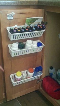 Use cheap baskets & 3M hooks to organize bathroom cabinets. Love it! Would be great for kitchen cabinet , sink, or classroom. by chandra