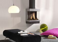 DRU - The Diablo - is a lovely three-sided fire that doesn't take up any floorspace. Its compact format and the fact that the fire is installed aginst the wall make it very discreet. The Diablo can be tailored to your own taste as it comes in three colours and in stainless steel. As such it is a great favourite in living rooms. In addition, its low capacity of 3.5 kW mean this fire can be placed in pretty much any living space.