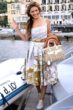 Kelly Brook in Italy.   Dolce and Gabbana and Louis Vuitton (I want to wear this all now)