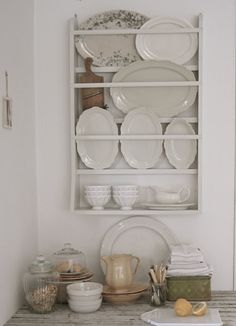 Plate shelf filled with ironstone platters