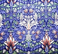 William Morris blue pattern with touches of a pale green and soft pink