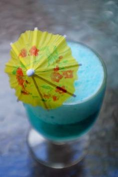 ~Blue Hawaii~ Blend 1 cup ice cubes, 1 ounce light rum, 1 ounce Blue Curacao, 2 ounces pineapple juice and 1 ounce Cream of Coconut in blender. Top with pinapple slice and a maraschino cherry. Don't forget the umbrella! Pinapple Juice, Pineapple, Blue Hawaii Cocktail, Tropical Drink Recipes, Hawaiian Cocktails, Tiki Lounge, Blue Curacao, Blue Hawaiian, Mixed Drinks