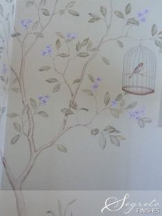 Pretty painted wall mural with a birdcage from Segreto
