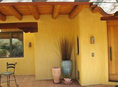 brightly painted stucco house in mexico | Tinted lime plaster is becoming very popular for new high-end home ...