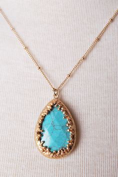 Turquoise teardrop necklace. I don't normally love pendants, but these colors are very pretty. And the metal fitting around the rock as well.