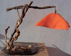 """Lampada in legno marino realizzata con legni recuperati e trattati con prodotti naturali olio di lino per risaltare le venature, la lampada è alta 53 cm la base è 34 x 19 cm, il portalampada è sostenuto da un ramo incastrato alla struttura portante. Il paralume è realizzato in tessuto """"canapone"""" colorato mentre il porta lampada è incastrato all'interno di un barattolo di vetro. Rifinita con corda di iuta. Il cavo elettrico è intrecciato nel telaio ed è realizzato con tela dorata stile…"""