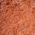 Red Dyed Mulch. Made of finely ground wood and dyed red in colour. As a ground cover for gardens. Helps to hold moisture. Applied to a depth of 2 – 3 inches  Landscape and gardening materials delivered right to your door!!!