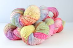 Colour - variegated butter yellow, sky, tangerine, lime, candy pink, amethyst, purple, natural white  Available in:    Sutherland DK  75% Fine superwash Merino, 20% silk, 5% silver Stellina  Double Knit, 100g skeins, 211 metres per 100g  Tulbagh Sock 80% Fine superwash Merino, 10% Cashmere, 10% Nylon  Sock/4-ply, 100g skeins, 400 metres per 100g.    Hand wash recommended, dry flat Yellow Sky, Pink Amethyst, Pink Candy, Double Knitting, Yarns, Sock, Cashmere, Lime, Butter