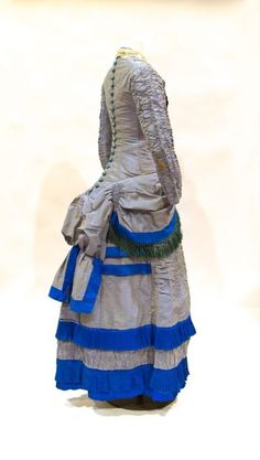 Dress (rear view), silk woven pattern with fringe trim, provenance: worn in St. John New Brunswick by Mary Connell, unlabelled, altered in about 1880 from mid 1870s original style, 09.04.01 donor: Margaret Moon