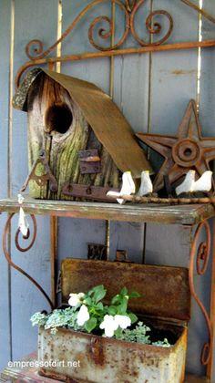 Rusty shelf, birdhouse, hardware, and tool box at the The Rusty Garden Art Gallery  empressofdirt.net.