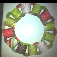 Paper chain wreath. Quick, satisfying kid craft to hang and embellish. Going to make mine with pages from an old children's book.