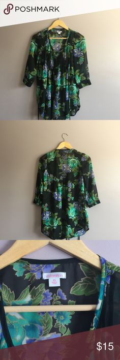 """Xhilaration Floral Top Xhilaration Floral Top  •Size: X-Small •Material: 100% polyester •Shoulder to shoulder: 12"""" •Armpit to armpit: 17"""" •Length: 29.5"""" •Sleeve length: 18"""" (3/4 quarter length) •Machine wash cold  •From a smoke-free home  Fast shipping (same day) during business days   No trades  Bundle & save!! Xhilaration Tops Blouses"""