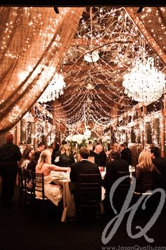 Barn wedding with chandeliers like you were saying! I like all the twinkle lights too : )
